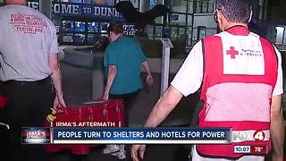 People Turn to Shelters and Hotels for Power - Video