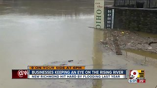 Businesses keeping an eye on rising river