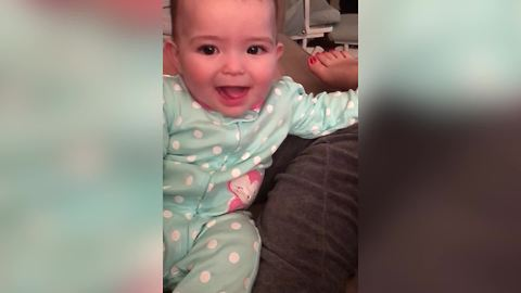 A Cute Baby Girl Says Dada When Her Mom Asks Her To Say Mama