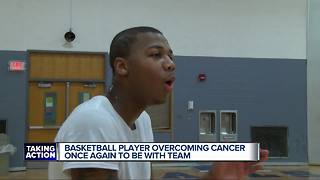 Basketball player overcoming cancer once again to be with team - Video