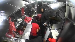 Los Angeles Police release taco truck robbery footage - Video