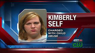 Woman arrested on charges of child abuse - Video