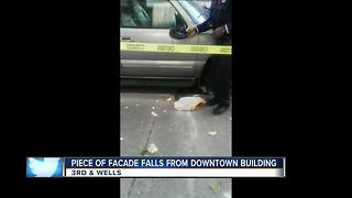 Concrete falls off downtown building 8 stories onto SUV below - Video