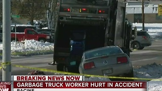 Racine Police investigating collision involving garbage truck and vehicle - Video