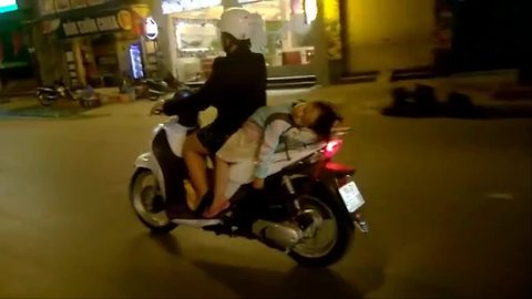 Little girl takes nap on back of speeding scooter