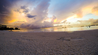 Time lapse: Beach sunset captures stunning lightning storm - Video