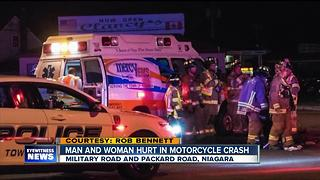 Two people hurt in motorcycle vs. car crash - Video