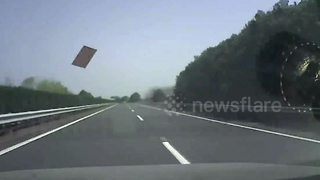 Dash-cam video captures moment flying iron plank smashes windscreen