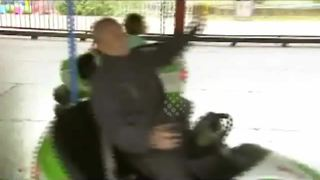 Chinese grandfather shares bumper car enthusiasm with granddaughter - Video