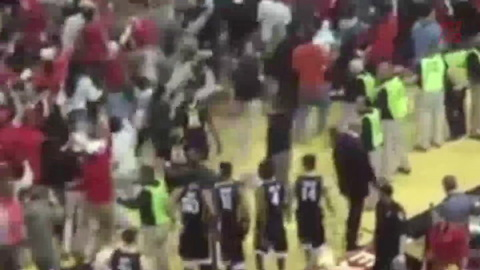 West Virginia Basketball Player Punches Fan As Fans Rush The Court