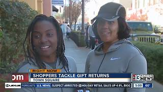 Local malls packed with shoppers returning gifts and catching sales - Video