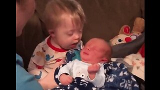 With a Little Help From His Aunt, Toddler With Down Syndrome Holds Baby Cousin for the First Time
