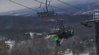 Ski lift malfunction leaves riders hanging - Video