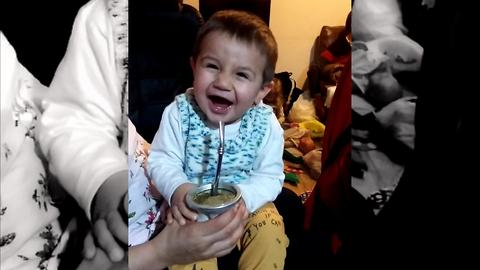 Look at the reactions of this baby while he drinks bitter South American drink called Mate