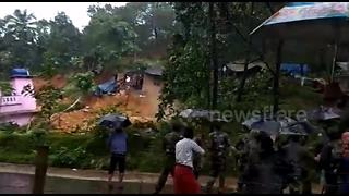 Horror moment villagers watch landslide burying their homes