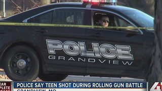 Police say teen shot during rolling gun battle - Video
