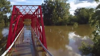 River Overflows Onto Bridge in Midland, Michigan - Video
