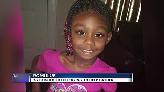 7-year-old killed trying to help father - Video
