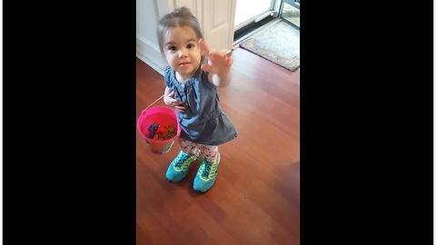 Toddler struggles to walk in mommy's shoes