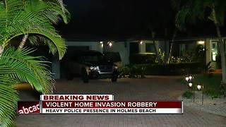 Police investigating violent home invasion in Holmes Beach - Video