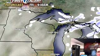 Chance light snow shower Thursday