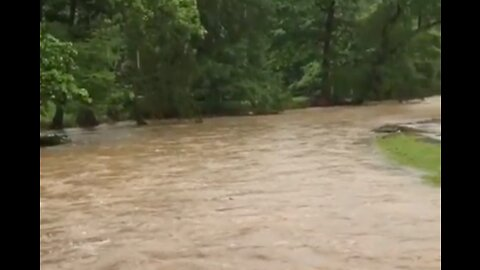 Arkansas creek turns to 'raging river' as storms sweep state
