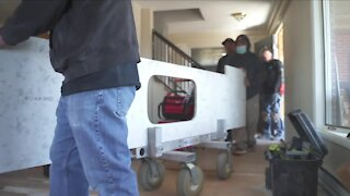 Group of contractors, military organizations, volunteers complete construction projects for military widow