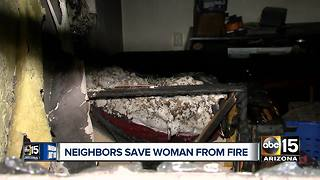 Neighbors save wheelchair-bound woman from house fire - Video