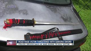 Police: Man threatens other driver with a samurai sword in a road rage attack - Video