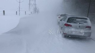 Giant snow drifts bring Greater Manchester roads to a standstill - Video