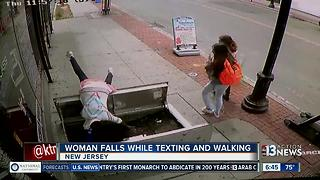 Woman falls while texting and walking