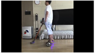 Dad uses hoverboard to clean the floors - Video