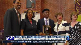 Local hero who saved woman from burning building credits mom for guiding him - Video