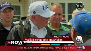 President tours damage, meets victims - Video