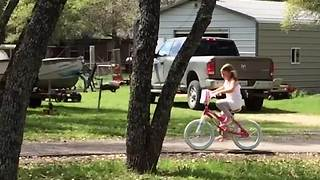 Little Girl On A Bike Crashes Into Tree - Video