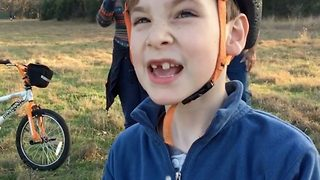 Hilarious moment tech-savy seven-year-old pulls out troublesome tooth with a drone