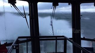 Tug powers into Storm Caroline's huge waves - Video