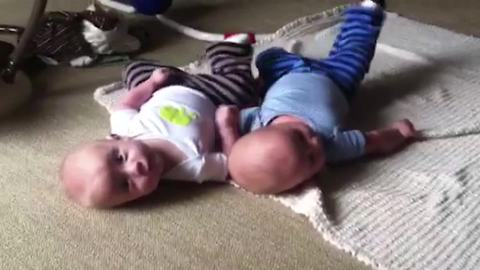 """Baby Twins Roll Over and Kick Same Leg"""