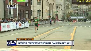 Runners cross the finish line at the Detroit Free Press/Chemical Bank Marathon - Video