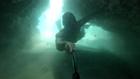 Diver explores breathtaking underwater cave