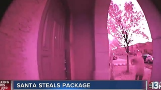 Thief wearing Santa hat steals package off porch