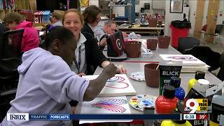 High school art students help adult artists with disabilities - Video