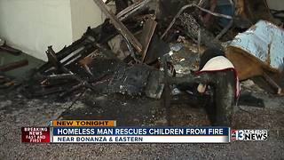 Homeless man saves children from burning apartment - Video