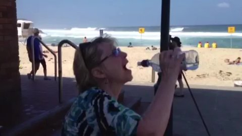 Woman Struggles with Water Bottle