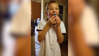 Young Boy Eats A Whole Cupcake In One Bite - Video