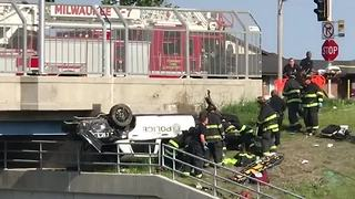 One officer killed, one hospitalized in Milwaukee Police squad car rollover crash - Video