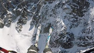 """I ski-lieve I can fly"" – Fearless skier shoots off cliff edge, paragliding into mountain depths below - Video"
