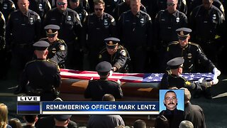Full military flag presentation for MPD Officer Lentz