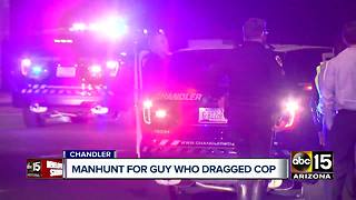 Manhunt underway for man who dragged Chandler officer with his car - Video