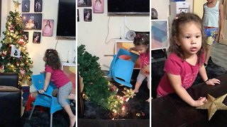 Christmas tree fail: Christmas tree comes crashing down on toddler - Video